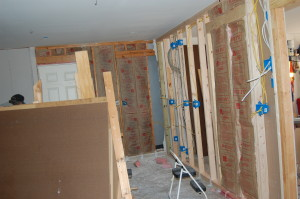 As drywall is hung on the outside of the partition wall, insulation goes up on the inside.